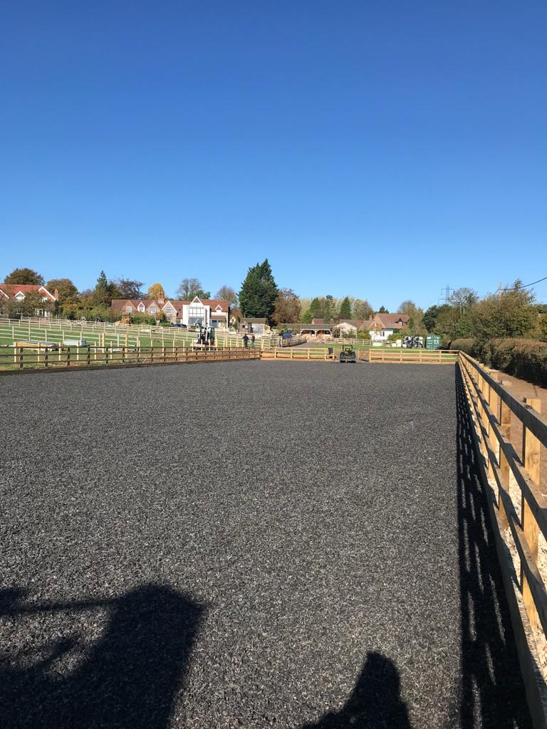 equestrian arena with wooden fencing around